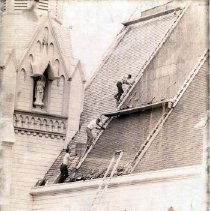 Image of 2011.61.874 - First Presbyterian Church undergoing roof repairs.