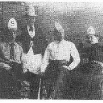 Image of 2014.2.153 - Four People with Paper Firefighting Helmets