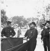 Image of 2014.2.179 - Uniformed men hold a chute at Napa State Hospital ca. 1940s