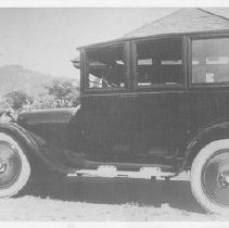 Image of 1989.31.15 - John W. Glover with his 1921 Dodge