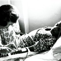 Image of Susan Koivun administering an IV to a local male patient.