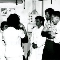 Image of Dr. Sgroi, Dr. Hayes (?sp), Dr. Davis Suskind in a group conference.