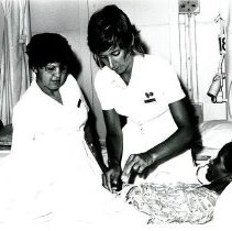 Image of HOPE nurse Susan Bies and her Brazilian counterpart.
