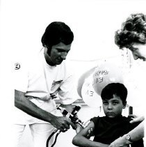 Image of Donald Epstein and Sister Mary Middenorf, public health nurse with patient