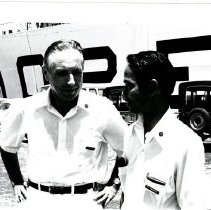 Image of Drs. Catalino Mendoza and Peter Weil posing in front of the SS HOPE.