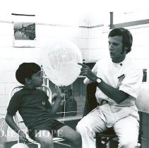 Image of Donald Epstein with young Brazilian boy after vaccination.