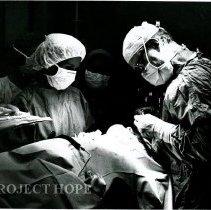 Image of Dr. Bert Wasserman in operating room with HOPE nurse.