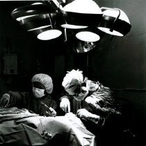 Image of Dr. Bert Waserman in operating room accompanied by HOPE nurses