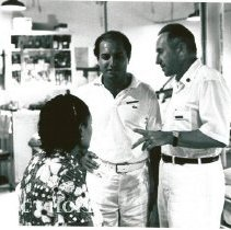 Image of Dr. Weil discussing a patient with his counterpart.