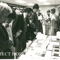 Image of Alumni Tour HOPE Center print shop during reunion Alice Mild far right