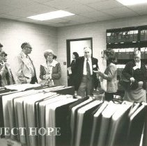 Image of far left:  John Wilhelm, others unknown in library at HOPE Center