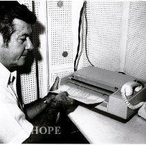 Image of Dr. William B. Walsh feeds a letter to President Nixon into COMSAT telecopi