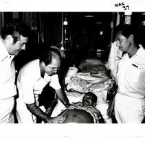 Image of William B. Walsh, Martin Shearn and Ulpio Miranda doing patient exam.