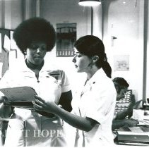Image of Mary Harrigan and Nadine Battle, a C-4 medical-surgical nurse.