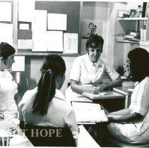 Image of Mary Harrigan in conference: Pat Endress, Martha Stohlhofer?, Karen Jessop