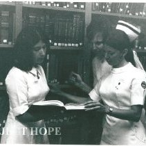 Image of Nurses in library.