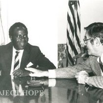Image of Dr. Walsh speak with Nigerian guest.