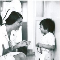 Image of Miss Nancy Hitt with a young Brazilian patient.