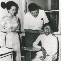 Image of Dr. Walsh with patient, Viet Nam - Voyage I