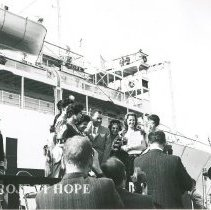 Image of Richard Nixon in front of the SS HOPE at ship dedication.