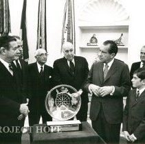 Image of Dr Walsh with Dignitaries - Dr. Walsh receiving an award from President Richard Nixon, Tom Walsh on right