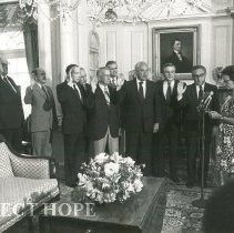 Image of Dr Walsh with Dignitaries - Swearing in, Dr. Walsh, Henry Kissinger, ?