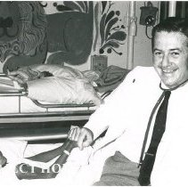 Image of Dr. Walsh with young Ceylonese patient aboard the SS HOPE.
