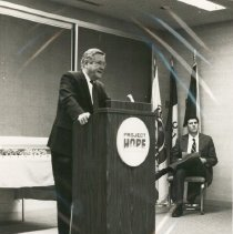 Image of Dr. Walsh speaking at HOPE Center and Bill Walsh