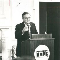 Image of Dr. Walsh speaking at Carter Hall.