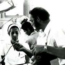 Image of Dr. George Fraley and medical students at dental school.