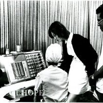 Image of Miss Jean Wilkins, EEG technologist, working with counterparts.