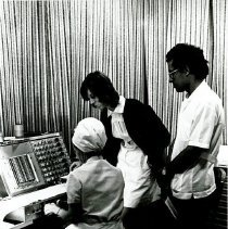 Image of Miss Jean Wilkins, EEG technologist, working with counterparts on SS HOPE