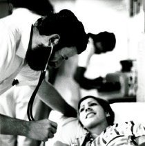 Image of Dr. Manelis examining female patient.