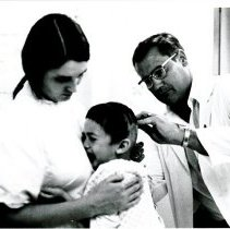 Image of Dr. Geise and pediatric nurse, Nancy Hitt with patient