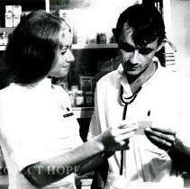 Image of ICU nurse Kathy Rheingans and counterpart Jonas Souza