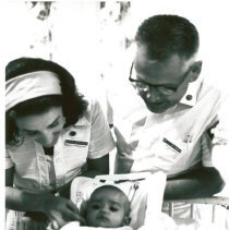 Image of Olga Verduzco and Dr. Teague Chisholm with patient