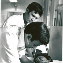 Image of Dr. Charles Billings and Dr. David McNutt seeing patient.
