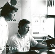 Image of Sister Dolores Mikula, X-ray Tech, reviewing with Dr. Albert Sheetz