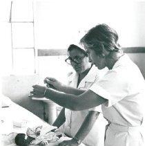Image of Yolande Albert with nurse counterpart.