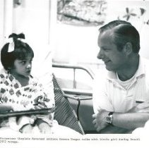 Image of Rev. Dawson Teague, protestant chaplain, with Peds II patient.