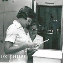 Image of Linda Warren, dental hygienist with Mrs. Miller, wife of Dr. Baxter Miller