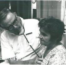 Image of Dr. Monford Custer and a patient on the female ward.