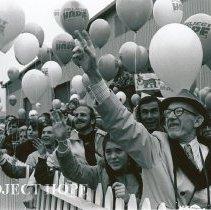 Image of Carl Payden and crowd greet ship at Homecoming.