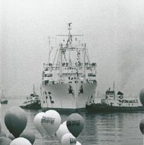 Image of SS HOPE comes into dock at homecoming with balloons
