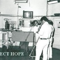 Image of First medical satellite transmission. Patient appears on TV screen.