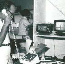 Image of Dr Stanley Wolfe talking to Washington via COMSAT.