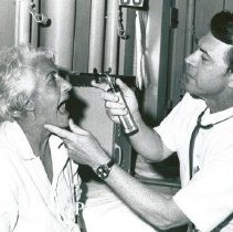 Image of Dr. George Miners, Internist, with patient.