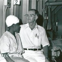 Image of Dr. Gerald Haines, Neurosurgeon, with patient.
