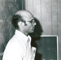 Image of Dr. Henry Soloway, Pathologist, giving a lecture.
