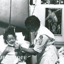 Image of Sister Theo Mandragos, Physical Therapist, working with a child.